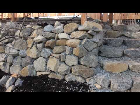 Rock Retaining Wall and Cedar Privacy Fence with Gate