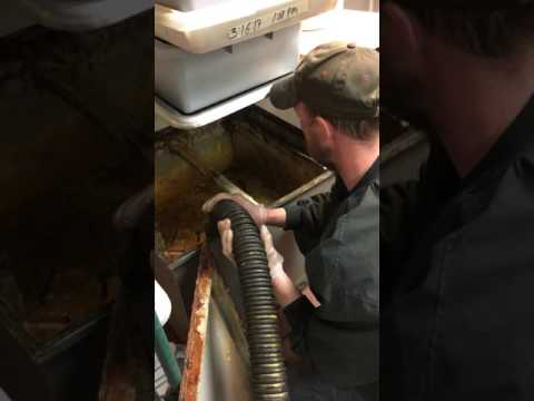 Septic Technician Cleaning Grease Trap