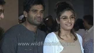 Raveena Tandon and Suniel Shetty on the sets of a Bollywood movie