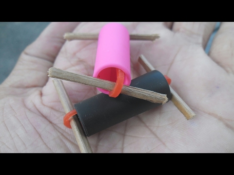 How to make a simple robot or toy using a pen and rubber band