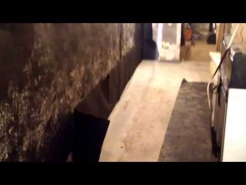 Part 2: strapping and installing tar paper in the basement