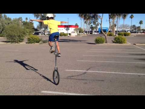 9 Yrs Old Kid Mounting His Tall Unicycle