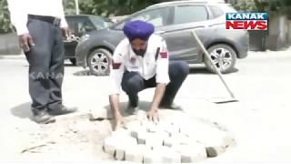 Traffic Cop Fixing Potholes & Avarting Road Accident At Punjab