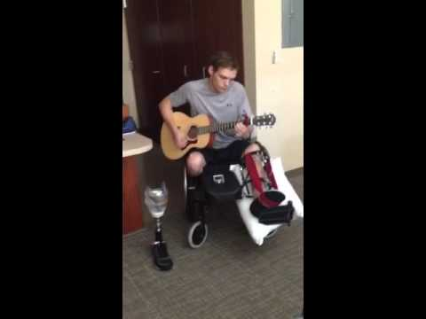 Eric playing the guitar again 4 months after stepping on IED bomb. Great!