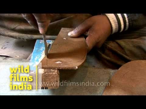 Hand-made leather boots being made from scratch