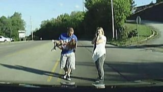 Firefighter helps girl after she falls out of moving bus