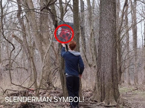 I FOUND A SLENDERMAN SIGN IN OUR WOODS!! *IT WAS IN A TREE*