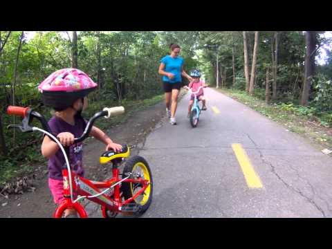 2 year old twins on two wheels