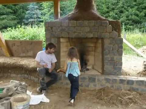 Cob Dragon rocket mass heater bench and 2 rumford fireplaces