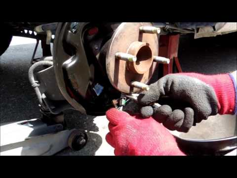 How to change rear drum brake and front caliper brakes on a chevy cobalt 2007