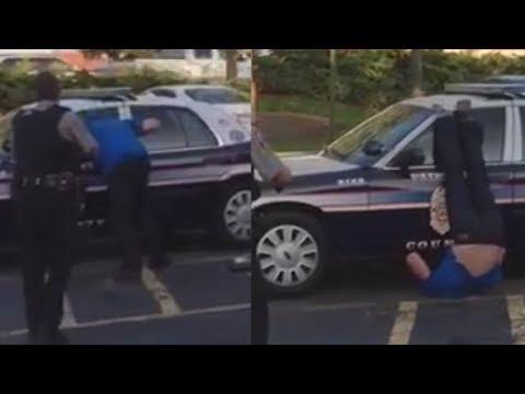 Guy slams his head into police car 10 times