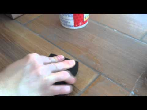 How to remove dried grout from floor tile surface