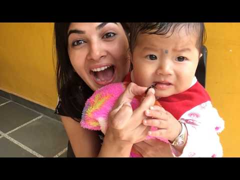 Cute Nepali Baby tastes nepali titaoura/paun candy for the first time (try not to grin or smile)