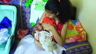 Happy young mother is feeding her baby - a newborn baby - Mom and baby tutorial videos: 263