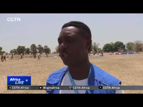 South Sudan residents start to receive food donations