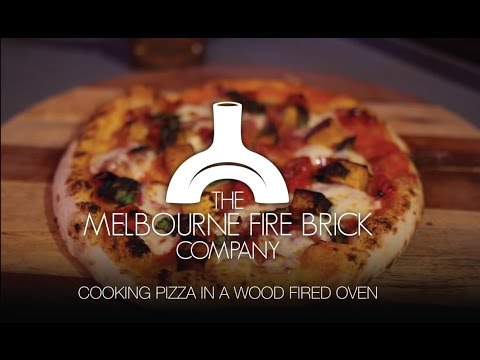 Cooking a Pizza in our Wood Fired Oven