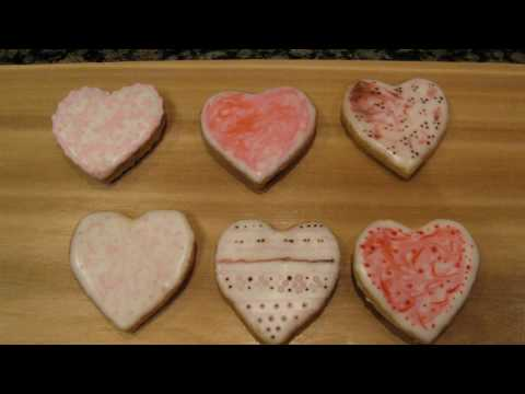 Hearts   marbled     pink  on white flood icing