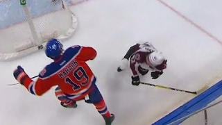 Maroon spins and crunches Barberio along the boards