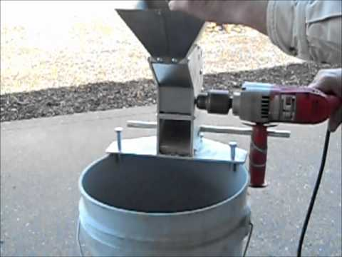 Drill powered nut cracker