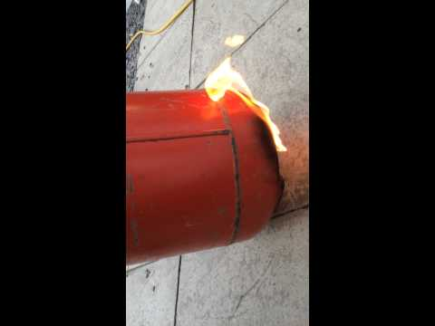 Removing residual gas from empty gas bottle.