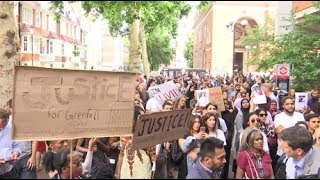 Protesters storm city building in London over Grenfell fire