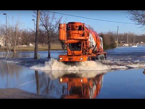 Flood waters don't stop concrete mixer truck