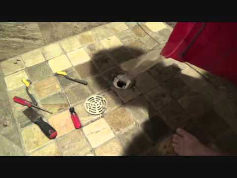 How to clean & flush out a shower drain