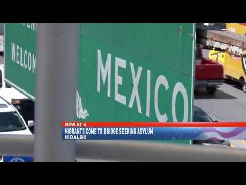 Migrants come to bridge seeking asylum