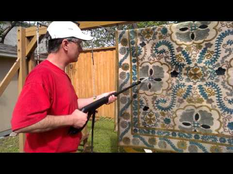 How to clean a rug with a power washer