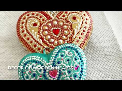 Decor of wooden hearts. Dot painting.