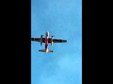 SMALL PLANE FLIES OVER HOUSE