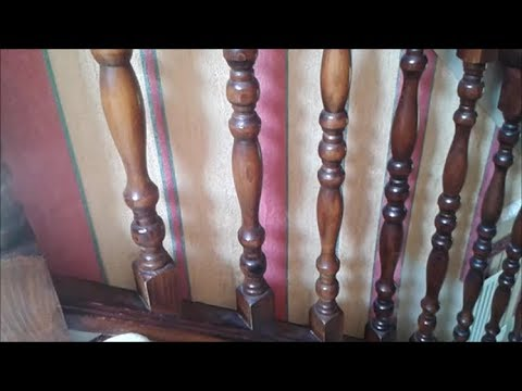 Decorating a staircase painting behind spindles