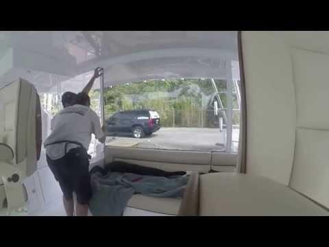 Tinting Eisenglass - 45' Hatteras Yacht Window Film Installation