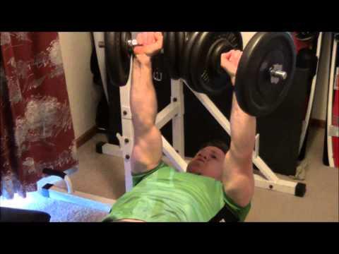 45 kg (100 lb) Dumbbell Bench Press