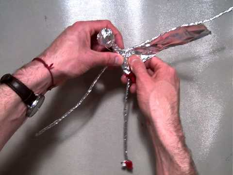 Wrapping aluminum foil around the head and torso (part 5/6).MOV