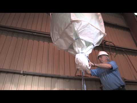Discharging full open dump Super Sack® Containers