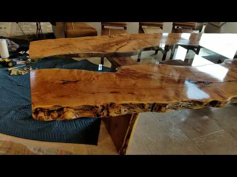 Live edge slab dining table during installation