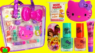 Hello Kitty Lip Gloss Nail Polish Num Noms and Surprises with Toy Genie.  This is a kids makeup video.  In this video, there are Hello Kitty Lip Gloss and Nail Polish.  I also have a Num Nom Lip Balm surprise.  Plus, I try out the new Pez Hello Kitty Candy.  Subscribe Here:  http://www.youtube.com/subscription_center?add_user=thetoygenie   Here are some links to my other videos that you may like:  DIY Disney Princess Treasure Box with Num Nom Lip Balms  Tsum Tsum, Shopkins and More:  https://youtu.be/7N-auEFn_tA  DIY Treasure Box by Melissa and Doug Lisa Frank Lip Balms Shopkins and More:  https://youtu.be/3rugT1PMFgU  Shopkins Cosmetics Backpack and Surprises:  https://youtu.be/ajmh5azXYVk  Here are more of my videos in playlists:  Mickey Mouse Club House Friends and Disney Tsum Tsum Playlist: https://www.youtube.com/watch?v=H-dN4zNFmaM&list=PL8yauLj_sBJCRdwghIqXPNosIriV7WPjH  Shopkins Season 5 Playlist:  https://www.youtube.com/watch?v=4oVq4jVbPJ8&list=PL8yauLj_sBJDtdijPhov4kBELtbQOf-gd  My Little Pony Surprises, Playsets, and Dolls Playlist:  https://www.youtube.com/watch?v=yMFEc1P7_OM&list=PL8yauLj_sBJDqN2e0kB3AHJS9EpaD16fI  Play Doh Playsets, Velcro Foods, and Kitchen Playsets Playlist:   https://www.youtube.com/watch?v=rYPrCNRie5s&list=PL8yauLj_sBJCAk-VI6dCHs5NQLBcO7R2Y  ABC123 Kids Preschool Learning With Toys and Play Doh Playlist:  https://www.youtube.com/watch?v=nqYEXjvQMNg&list=PL8yauLj_sBJCKxWXXyG11aD5VpIqn8Jbv  Paw Patrol Surprises with Play Doh and Learning Playlist:  https://www.youtube.com/watch?v=nqYEXjvQMNg&list=PL8yauLj_sBJC94Mr-kxqznpPSUP12-9DW  Kids Makeup Cosmetics Lip Balm Playlist:  https://www.youtube.com/watch?v=1PHgWcuk7No&list=PL8yauLj_sBJB8qmsMQn1hK78V-MDXeqRu  Disney Princess and Disney Toys Playlist:  https://www.youtube.com/watch?v=LUquV7eqQak&list=PL8yauLj_sBJBReHXHVFlmtlRt_Ba1lCUl  Blind Bags, Blind Baskets, Mystery Boxes, Surprise Eggs Playlist:  https://www.youtube.com/watch?v=hiAH0iLOJq4&list=PL8yauLj_sBJAzX_EqBbiphR-mzobRgBCO  F