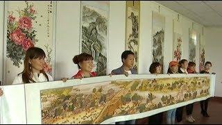 Retiree spent 7 years embroidering riverside scene at Qingming Festival