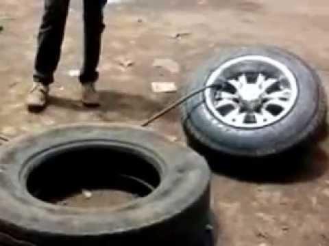 Changing tubeless car tyre in Kenya