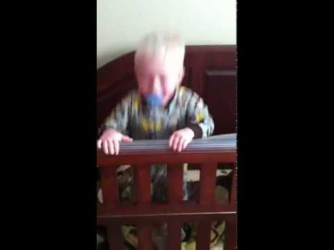 Eli jumping on his bed