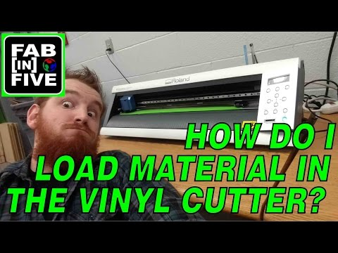How do I load material in the vinyl cutter?