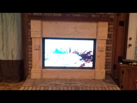 Tv in fireplace surround