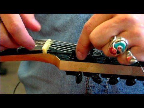 Electric Guitars : How to Change Electric Guitar Strings