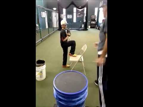 9 year old lefty demonstrates Chair andTowel baseball pitching drill