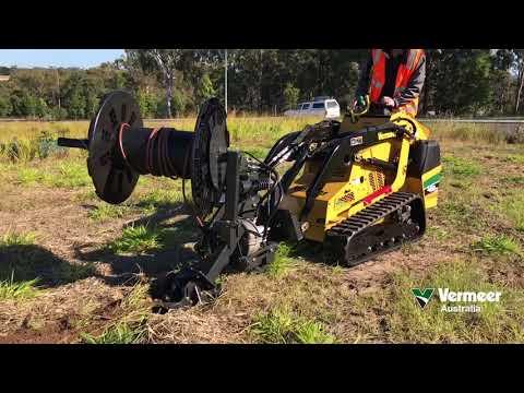 Vermeer mini loader with irrigation plow in Brisbane, Australia
