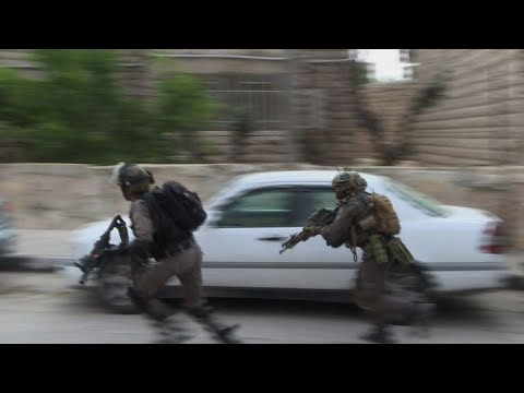 Israeli forces raid refugee camp, clash with Palestinians