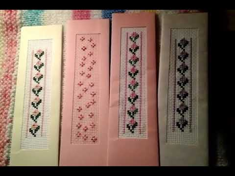 Cross stitch bookmarks and flower and knitted blanket.