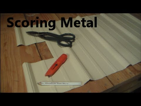 Score metal with a knife