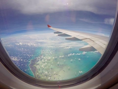For those who like to fly - airplane window view flying from Brazil to Miami over Bahamas sea